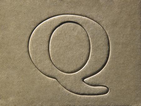 die cut alphabet q on the brown card board
