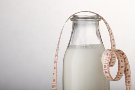 fresh milk and measuring tape 写真素材