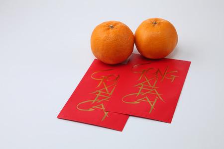 chinese new year celebration mandarin orange with ang pao