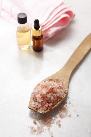 salt ,massage oil and towel on the table