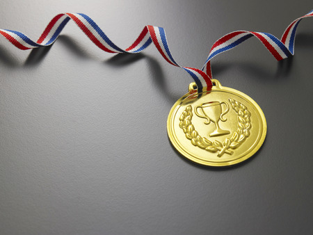 golden medal on the gray background Фото со стока