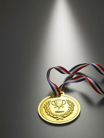 golden medal on the gray background Stock Photo