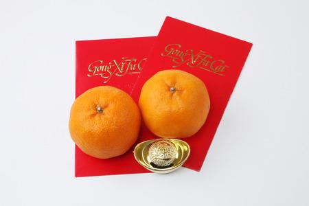 chinese new year celebration mandarin orange with ang pao and ingot