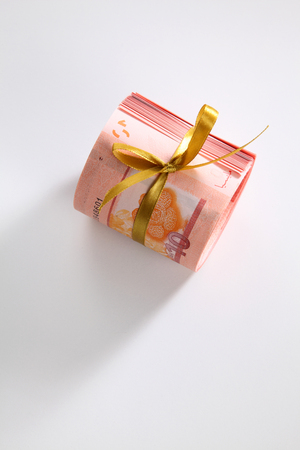 Malaysia ringgit roll tied with ribbon