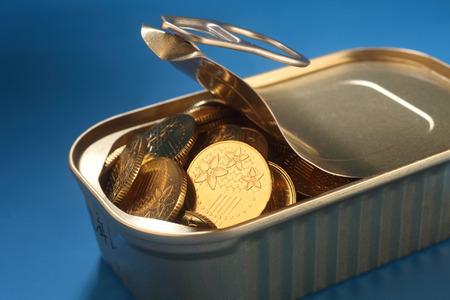 coin in the sardine can 版權商用圖片