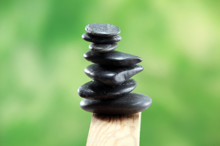 stack of stone on the green color background