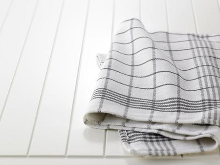 checkered napkin on wooden white  table Imagens