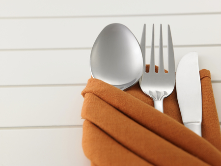 fork,spoon and knife in the folded napkin