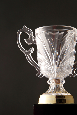 glass trophy on the black background
