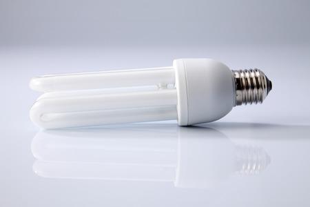 Energy saving fluorescent light bulb on white background Standard-Bild - 117974498