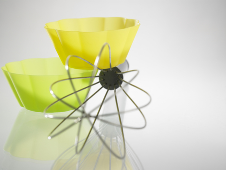 whisk and the silicone muffin holder Фото со стока