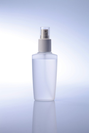White container of spray bottle isolated over white background