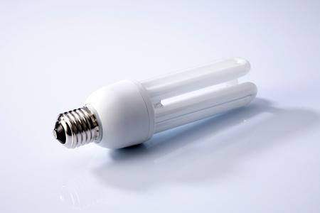 Energy saving fluorescent light bulb on white background Standard-Bild - 117972250