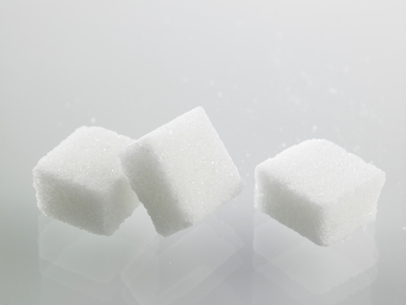 cube sugar on the gray background 스톡 콘텐츠