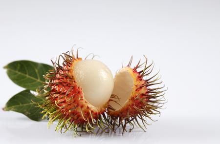 asian fruit rambutan on the plain background Фото со стока