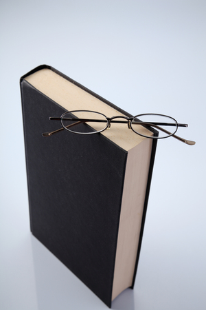 book and a pair of spectacle Stock Photo