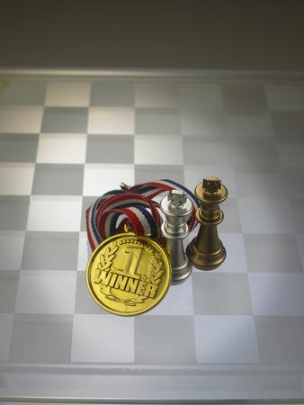 medal with chess pieces on the chess board 写真素材