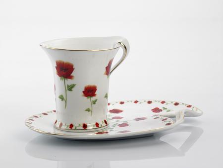 Antique porcelain tea cup on white background