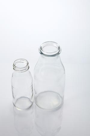 two different sizes og milk bottle