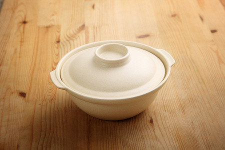 chinese empty clay pot on the wooden background