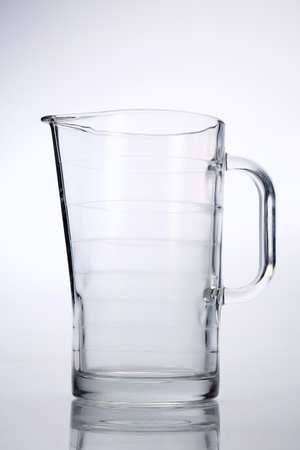 glass water pitcher on the white background