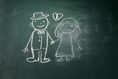 drawing on the chalkboard husband and wife breakup and women is being erase Stockfoto