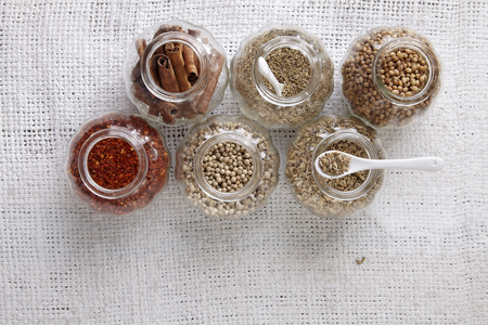arrangement of spices on the whith sackcloth Imagens