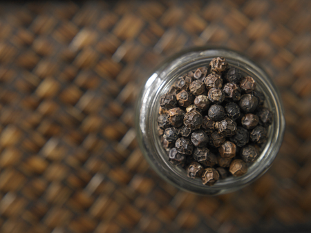 Top view black peppercorn in a glass container Imagens