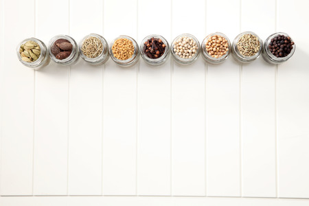 assorted spices in a row Stock Photo