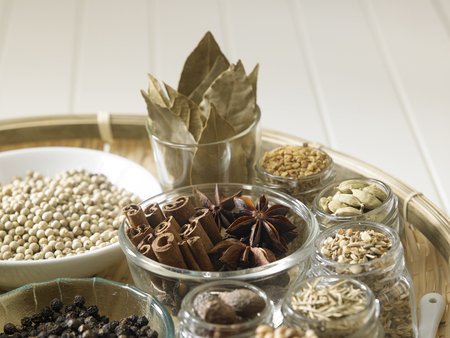 assorted spices on the white wooden background