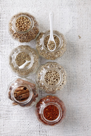arrangement of spices on the whith sackcloth 写真素材