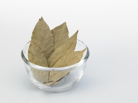 dried bay leaves in the glass container Imagens