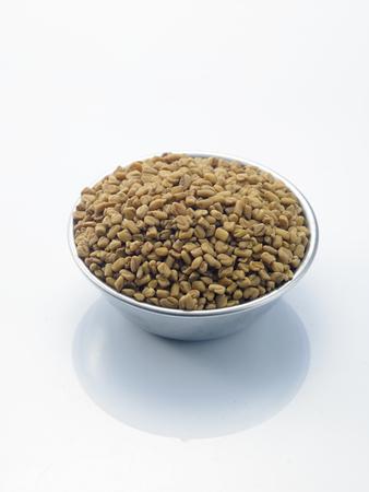 bowl of fenugreek on the white background