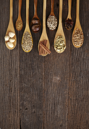 Spoon filled with assorted spices Stock Photo