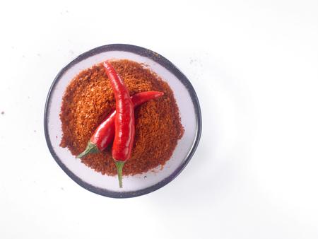 glass bowl of chili powder with chili padi Stock Photo