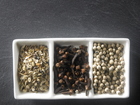 top view of the assorted spices on black slate Imagens