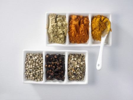 top view of assorted spices and powder on the white background Stock Photo