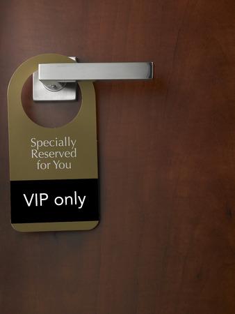 door sign special reserved for vip members Stock Photo
