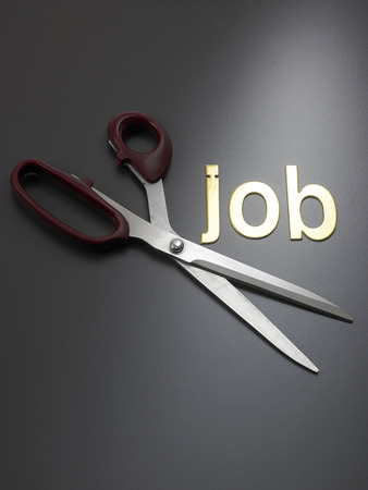 Job cutting concept for downsizing or unemployment issues