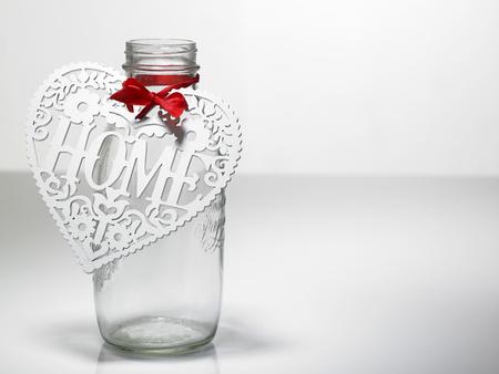 Heart shape on the jar savings. Banco de Imagens
