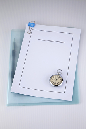 loan application document and stop watch Banco de Imagens