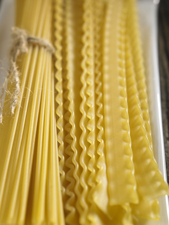 Variety of types and shapes of Italian pasta. Dry pasta background Stock Photo