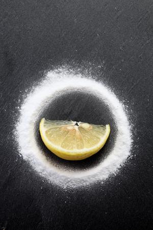 slice of lemon in the middle of baking soda powder 写真素材