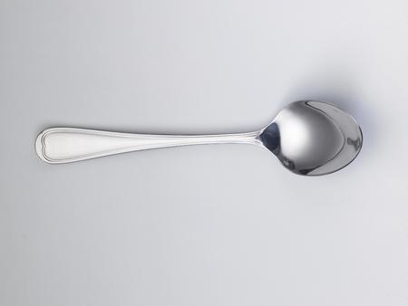 used spoon on the white background Reklamní fotografie