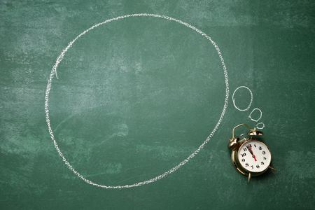 alarm clock with thinking bubble