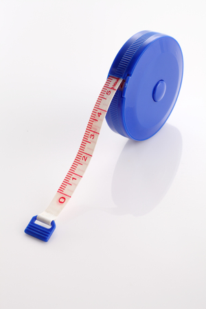 tape measuring tape on the white background Stockfoto