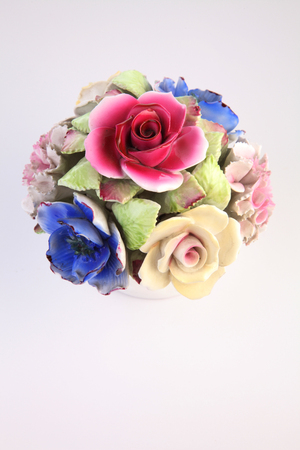 colorful porcelain flowers on the white background