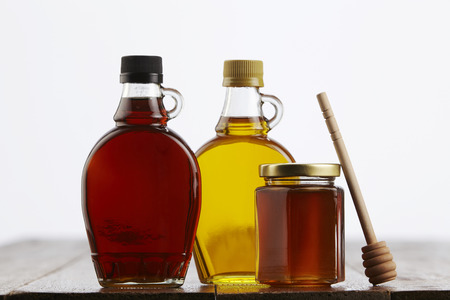 syrup and honey on the wooden background