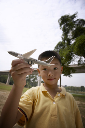 Boy playing with toy airplane Stockfoto