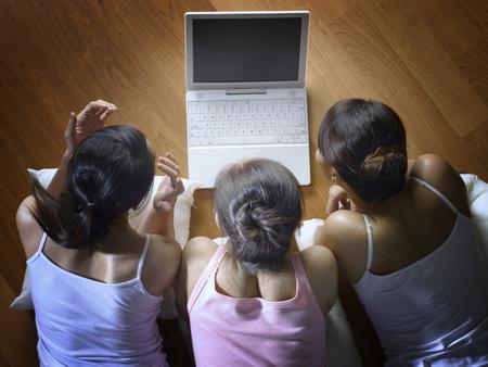 Friends watching movie on laptop